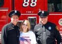 Two Firemen & Volonteer Laura Burkett